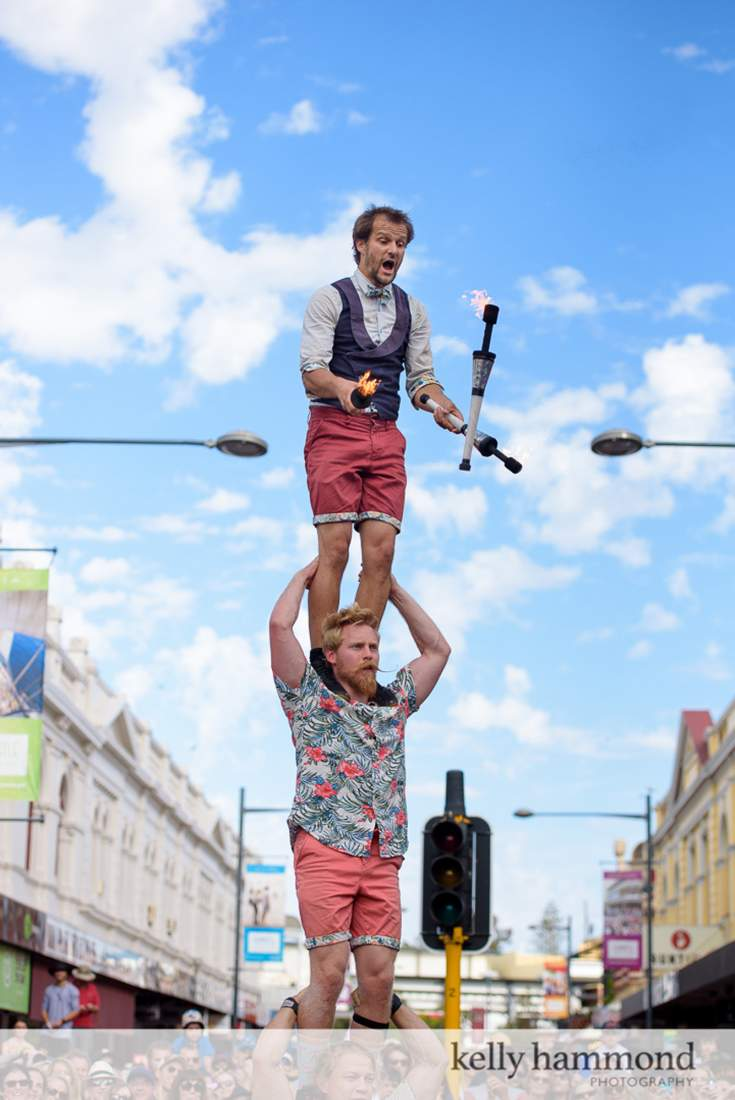 Three high fire juggling dangerous flyer base circus street show australia